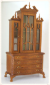 scale model of a wooden china cabinet