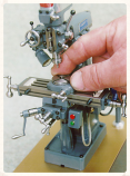 scale model of a miniature mechanical drill press
