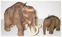 scale model of prehistoric pachyderm and a modern-day elephant