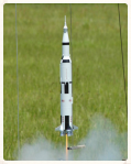 Image of a scale model N.A.S.A. rocket being launched