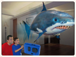 Image of a remote-controlled scale model blimp that resembles a shark