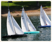 Image of scale model sailing boats afloat on a pond