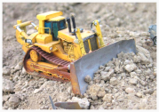Image of a remote-controlled scale model bull-dozer