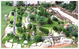 Image of a scale model train on display in a garden railroad